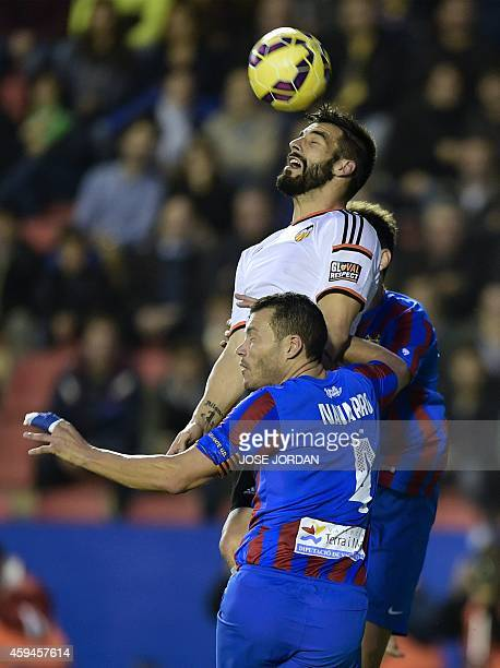 Valencia's forward Alvaro Negredo vies with Levante's defender David Navarro during the Spanish league football match Levante UD vs Valencia CF at...