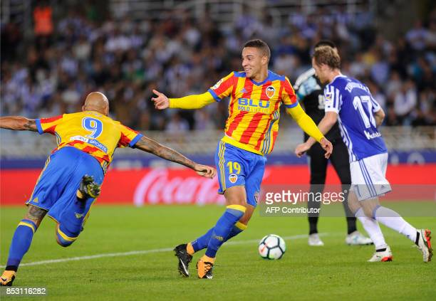 Valencia's forward from Spain Rodri celebrates with teammate forward from Italy Simone Zaza after scoring his team's first goal during the Spanish...