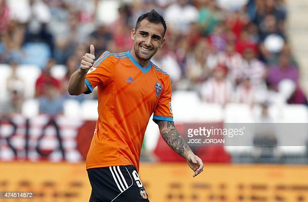 Valencia's forward Paco Alcacer thumbs up during the Spanish league football match UD Almeria vs Valencia CF at the Juegos Mediterraneos stadium in...