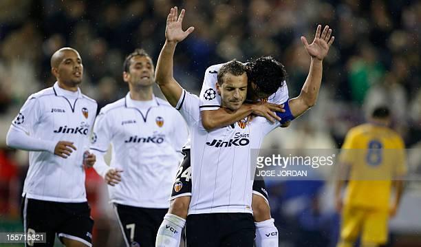 Valencia's forward Roberto Soldado celebrates with Valencia's Argentinian midfielder Tino Costa after scoring during the UEFA Champions League...
