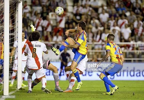 Valencia's forward Santi Mina vies with Rayo's midfielder Jose Raul Baena during the Spanish league football match Rayo Vallecano de Madrid vs...