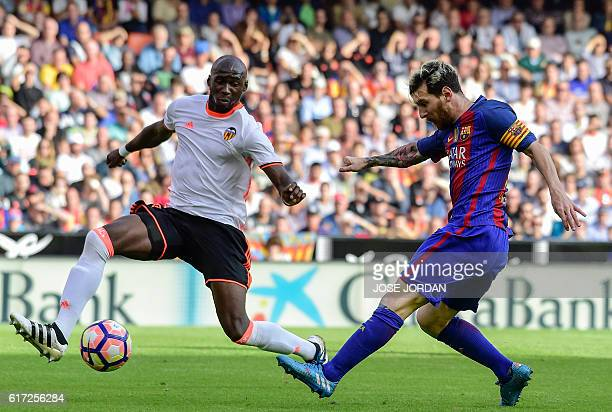 Valencia's French defender Eliaquim Mangala vies with Barcelona's Argentinian forward Lionel Messi during the Spanish league football match between...