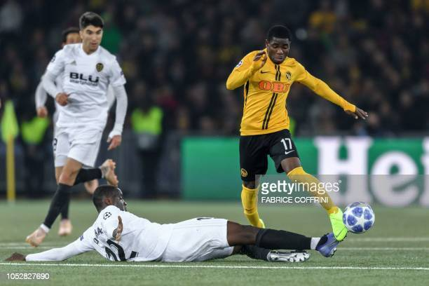 Valencia's French defender Mouctar Diakhaby and Young Boys' Ivorian forward Roger Assale vie for the ball during the UEFA Champions League Group H...