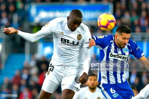Valencia's French defender Mouctar Diakhaby heads the ball with Alaves' Chilean defender Guillermo Maripan during the Spanish League football match...