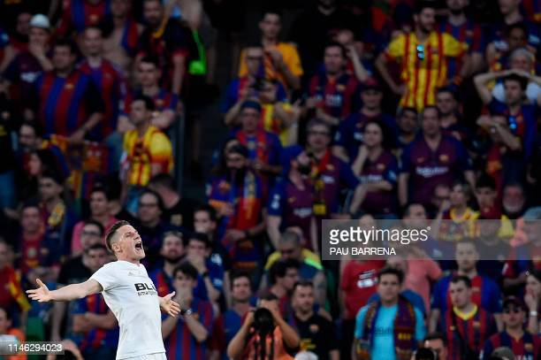 Valencia's French forward Kevin Gameiro celebrates after scoring goal during the 2019 Spanish Copa del Rey final football match between Barcelona and...