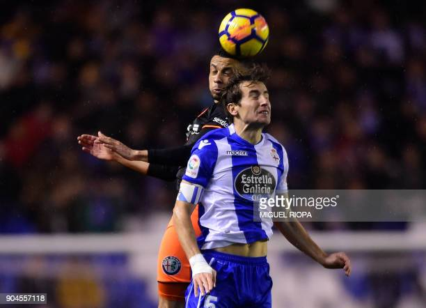 Valencia's French midfielder Francis Coquelin vies with Deportivo La Coruna's Spanish midfielder Pedro Mosquera during the Spanish league football...
