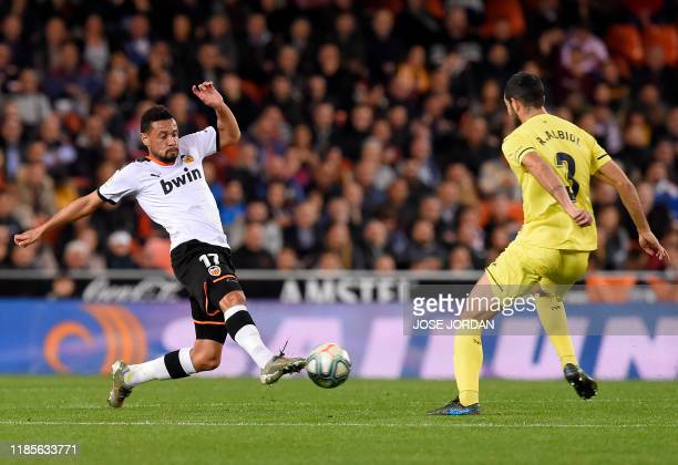 Valencia's French midfielder Francis Coquelin vies with Villarreal's Spanish defender Raul Albiol during the Spanish league football match between...