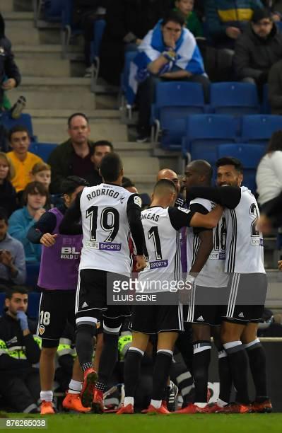 Valencia's French midfielder Geoffrey Kondogbia celebrates a goal with teammates during the Spanish league football match RCD Espanyol vs Valencia CF...