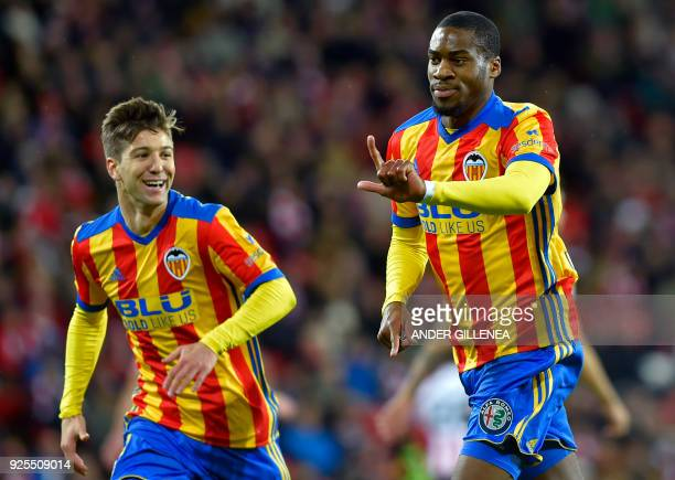 Valencia's French midfielder Geoffrey Kondogbia celebrates scoring a goal beside teammate Argentinian forward Luciano Vietto during the Spanish...