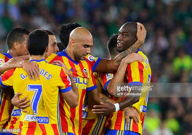Valencia's French midfielder Geoffrey Kondogbia celebrates with teammates after scoring a goal during the Spanish league football match Real Betis FC...