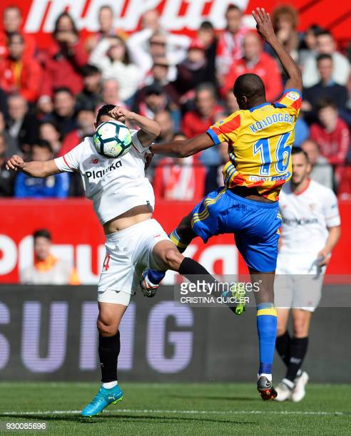 Valencia's French midfielder Geoffrey Kondogbia challenges Sevilla's Spanish forward Nolito during the Spanish league football match between Sevilla...