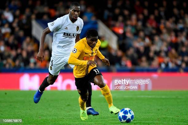 Valencia's French midfielder Geoffrey Kondogbia challenges Young Boys' Ivorian forward Roger Assale during the UEFA Champions League group H football...