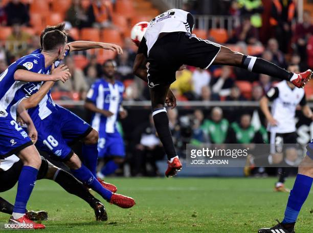 Valencia's French midfielder Geoffrey Kondogbia heads the ball during the Spanish 'Copa del Rey' football match between Valencia CF and Deportivo...