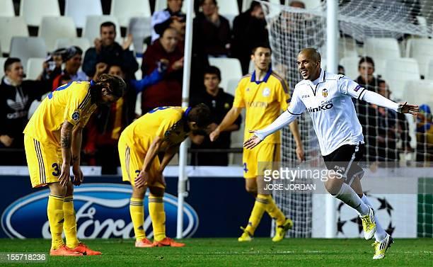 Valencia's French midfielder Sofiane Feghouli celebrates after scoring during the UEFA Champions League football match Valencia CF vs FC Bate Borisov...