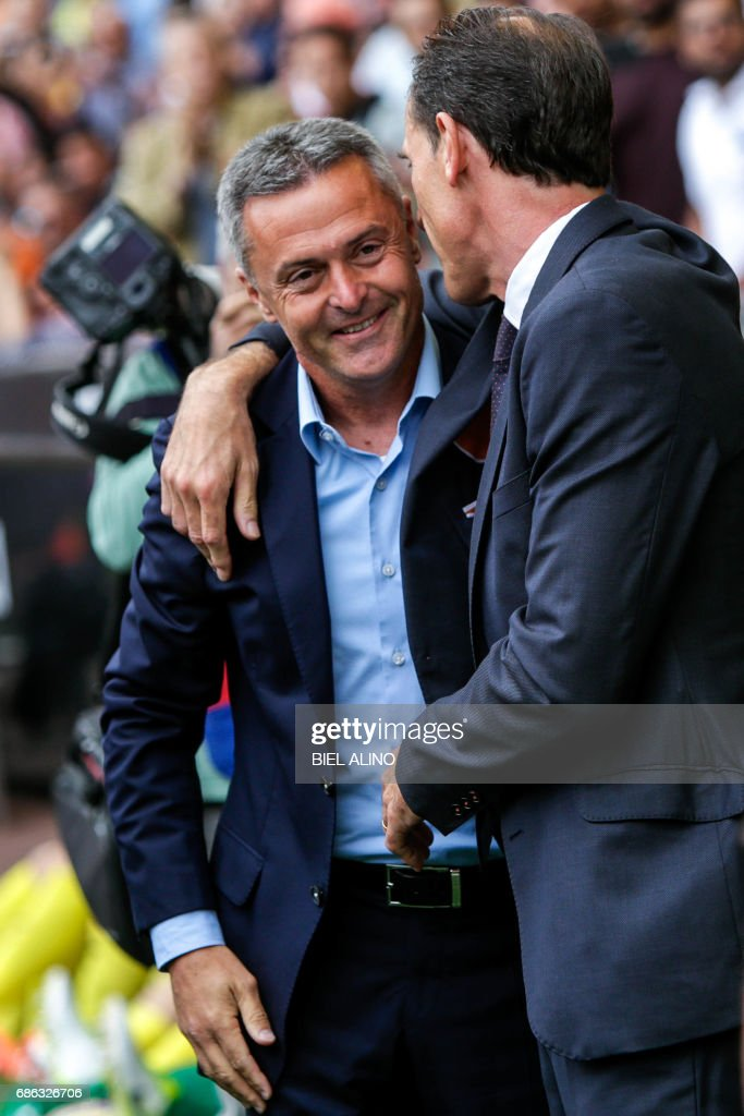 Valencia's head coach, Voro Gonzalez (R) cheers Villarreal's head coach, Fran Escriba (L), before the Spanish League football match Valencia CF vs Villarreal CF at the Mestalla stadium in Valencia on May 21, 2017. /