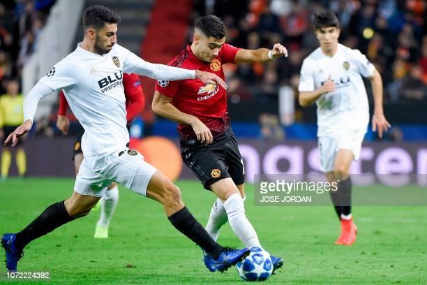 Valencia's Italian defender Cristiano Piccini challenges Manchester United's Belgianborn Brazilian midfielder Andreas Pereira during the UEFA...