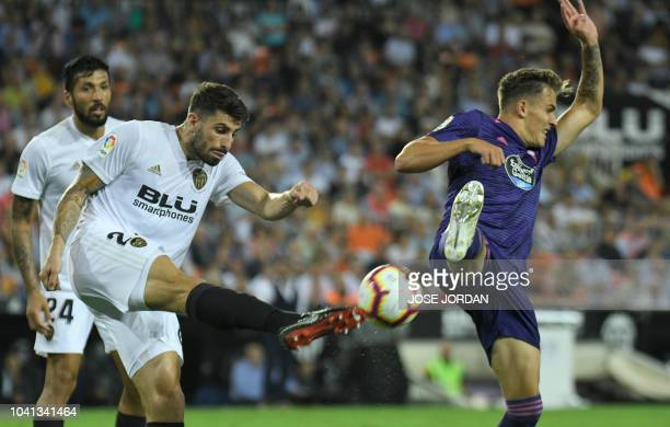 Valencia's Italian defender Cristiano Piccini vies with Celta Vigo's German midfielder Dennis Eckert during the Spanish league football match...