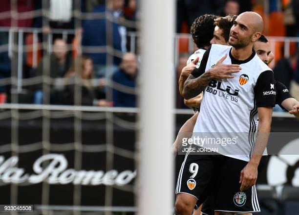Valencia's Italian forward Simone Zaza celebrates a goal during the Spanish League football match between Valencia CF and Deportivo Alaves at the...