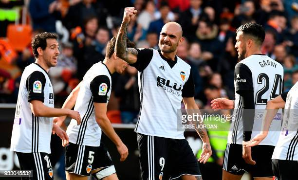 TOPSHOT Valencia's Italian forward Simone Zaza celebrates a goal during the Spanish League football match between Valencia CF and Deportivo Alaves at...