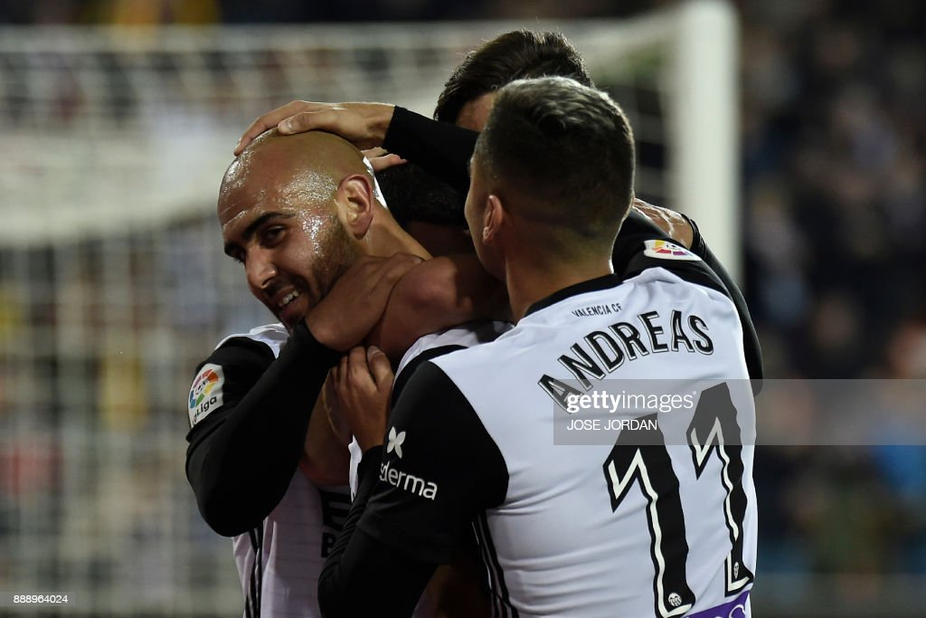 Valencia's Italian forward Simone Zaza (L) celebrates after scoring during the Spanish league football match between Valencia and Celta Vigo at the Mestalla Stadium in Valencia on December 9, 2017. /