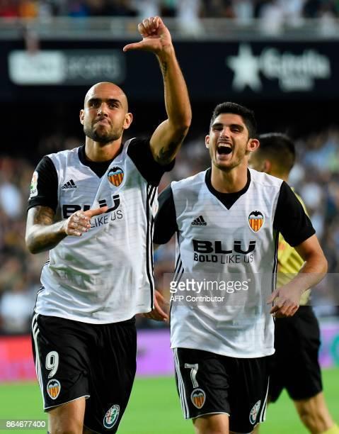 Valencia's Italian forward Simone Zaza celebrates with Valencia's Portuguese midfielder Manuel Guedes after scoring a goal during the Spanish league...
