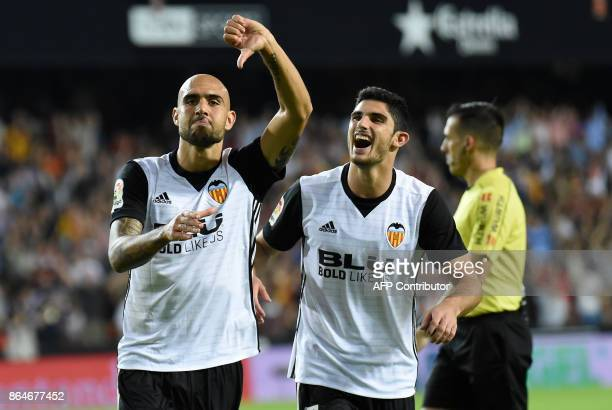 Valencia's Italian forward Simone Zaza celebrates with Valencia's Portuguese midfielder Manuel Guedes after scoring a goal during the Spanish league...