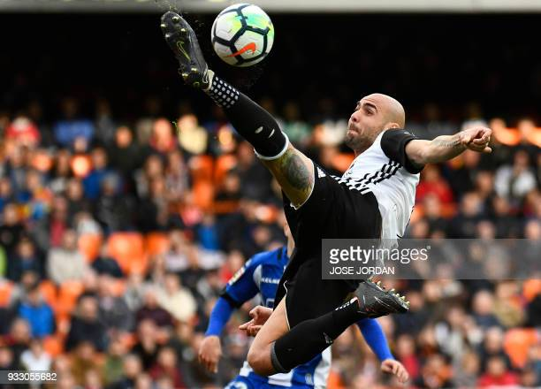 Valencia's Italian forward Simone Zaza controls the ball during the Spanish League football match between Valencia CF and Deportivo Alaves at the...