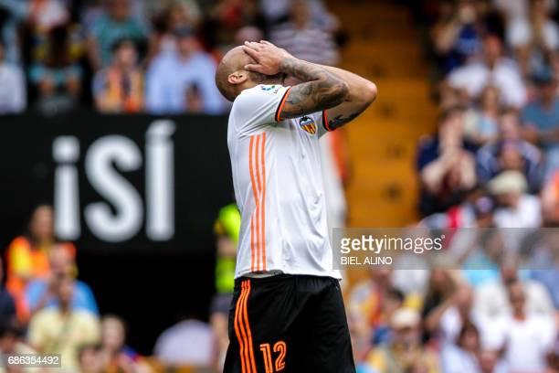 Valencia's Italian forward Simone Zaza gestures during the Spanish League football match Valencia CF vs Villarreal CF at the Mestalla stadium in...