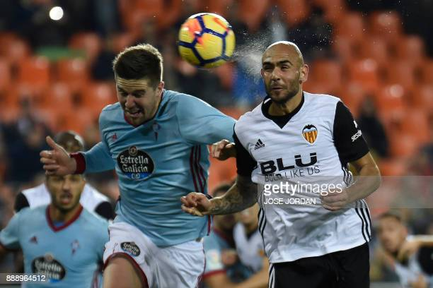 Valencia's Italian forward Simone Zaza heads the ball during the Spanish league football match between Valencia and Celta Vigo at the Mestalla...