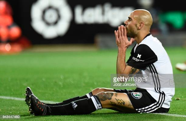 Valencia's Italian forward Simone Zaza reacts after missing a goal opportunity during the Spanish league football match between Valencia CF and RCD...