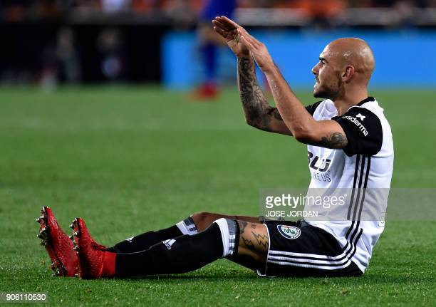 Valencia's Italian forward Simone Zaza sits on the field during the Spanish 'Copa del Rey' football match between Valencia CF and Deportivo Alaves at...