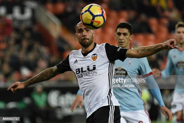Valencia's Italian forward Simone Zaza vies with Celta Vigo's Chilean midfielder Pablo Hernandez during the Spanish league football match between...