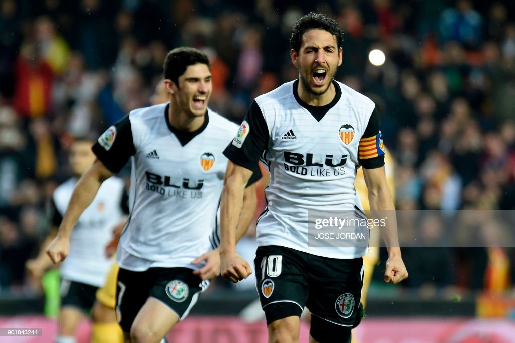 Valencia's midfielder Dani Parejo celebrates after scoring a goal during the Spanish league football match between Valencia and Girona at the Mestalla stadium in Valencia on January 6, 2018. /