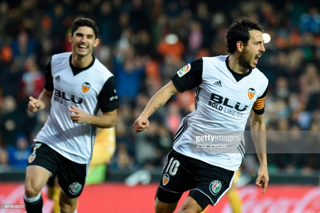 Valencia's midfielder Dani Parejo (R) celebrates after scoring a goal during the Spanish league football match between Valencia and Girona at the Mestalla stadium in Valencia on January 6, 2018. /