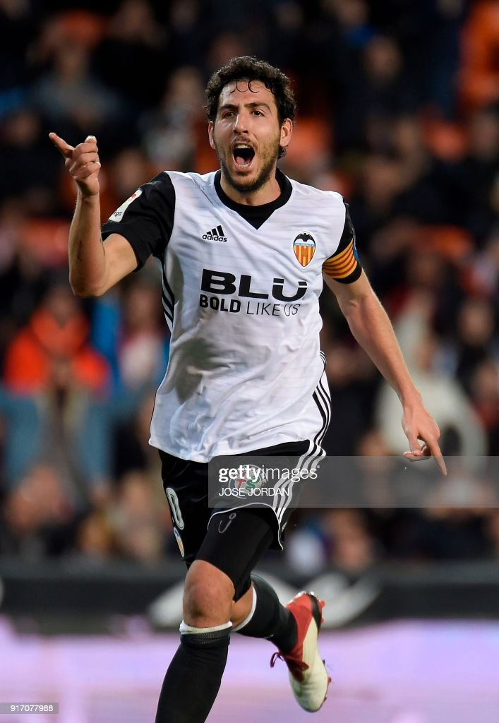 Valencia's midfielder Dani Parejo celebrates after scoring during the Spanish league football match between Valencia CF and Levante UD at the Mestalla stadium in Valencia on February 11, 2018. /