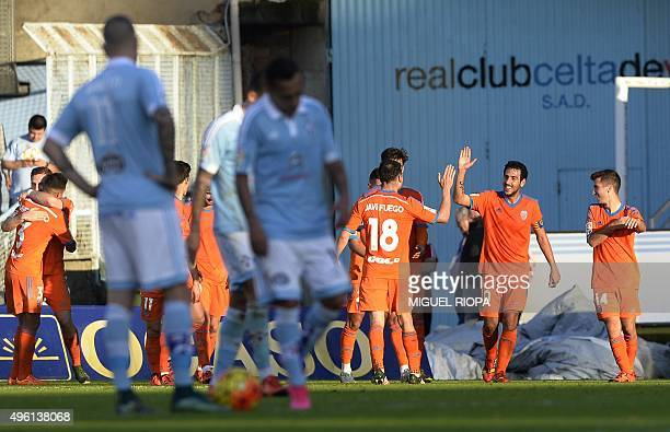 Valencia's midfielder Dani Parejo celebrates with teammates after scoring a goal during the Spanish league football match RC Celta de Vigo vs...