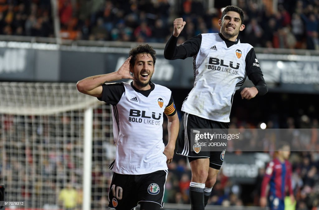 Valencia's midfielder Dani Parejo (L) celebrates with Valencia's Portuguese midfielder Manuel Guedes after scoring during the Spanish league football match between Valencia CF and Levante UD at the Mestalla stadium in Valencia on February 11, 2018. /