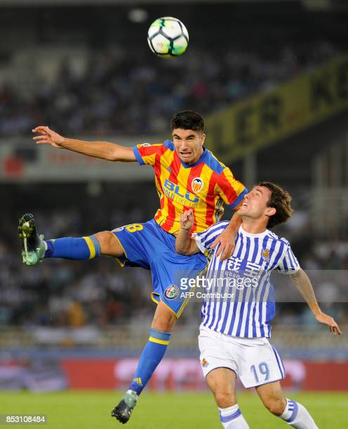 Valencia's midfielder from Spain Carlos Soler vies with Real Sociedad's defender from Spain Alvaro Odriozola during the Spanish league football match...