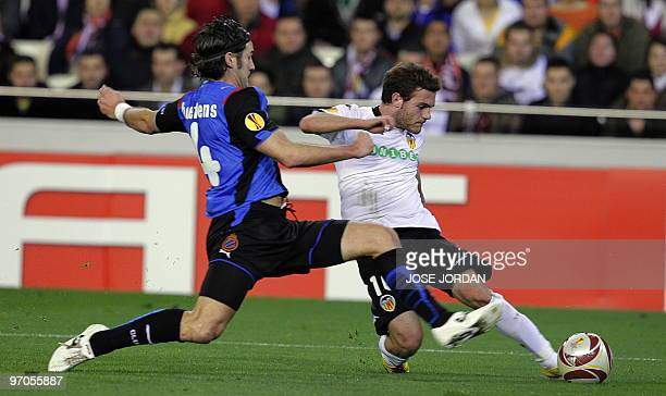 Valencia's midfielder Juan Mata fights for the ball with Brugge's Carl Hoefkens during their Europe league football match at Mestalla Stadium in...