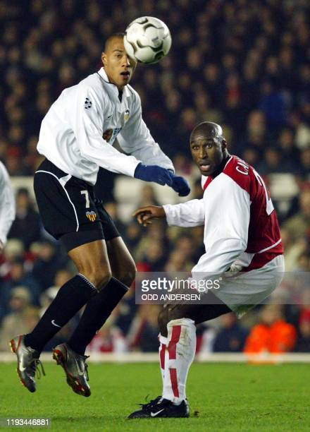 Valencia's Norwegian striker John Carew heads the ball past Arsenal's Sol Campbell during their UEFA Champions League Group B match at Highbury 10...