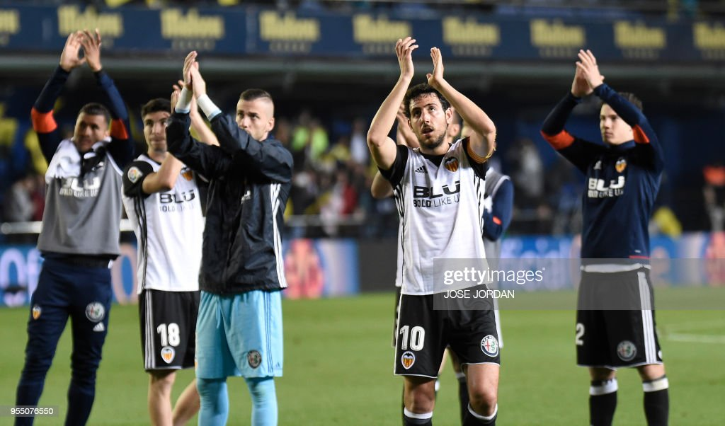 Valencia's players acknowledge fans at the end of the Spanish league football match between Villarreal and Valencia at the La Ceramica stadium in Villarreal on May 5, 2018.
