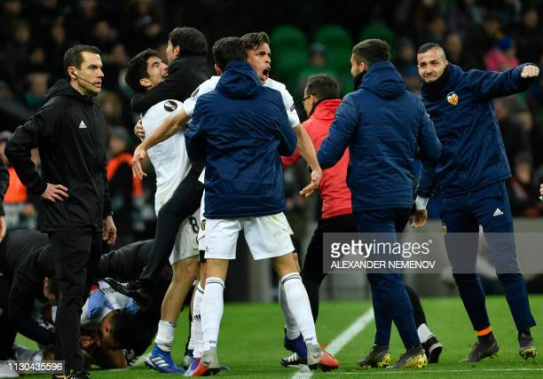 Valencia's players celebrate a goal during the UEFA Europa League round of 16 second leg football match between FC Krasnodar and Valencia CF at the...