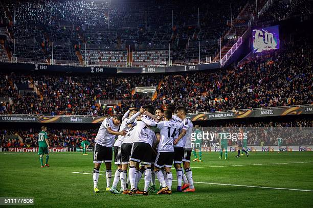 Valencia's players celebrate a goal during the UEFA Europa League Round of 32 first leg football match Valencia CF vs SK Rapid Wien at the Mestalla...