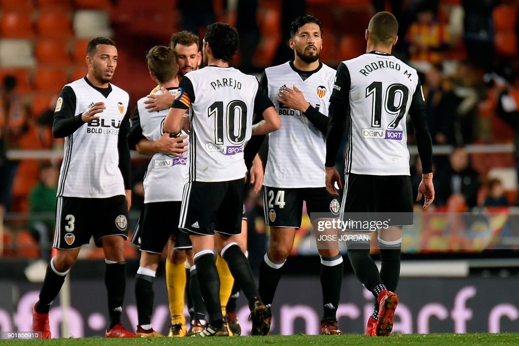 Valencia's players celebrate at the end of the Spanish league football match between Valencia and Girona at the Mestalla stadium in Valencia on January 6, 2018. /