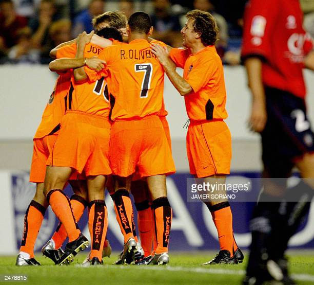 Valencia's players celebrates after scoring their first goal during their Spanish League match at the El Sadar stadium in Pamplona 02 September 2003...