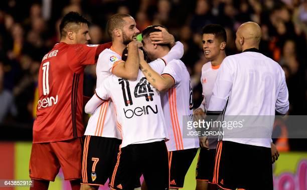 Valencia's players celebrates after the Spanish league football match Valencia CF vs Real Madrid CF at the Mestalla stadium in Valencia on February...