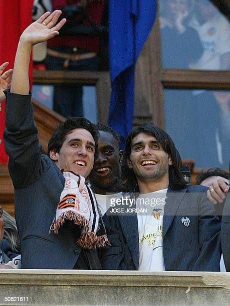 Valencia's players Vicente Rodriguez French Mohamed Sissoko and Argentinian Fabian Ayala celebrate Valencia's Spanish league title win in Valencia10...