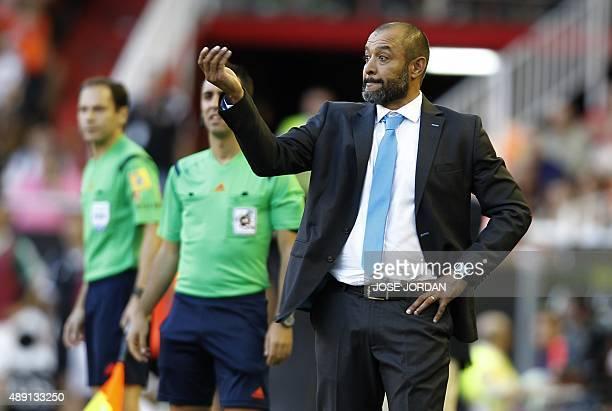 Valencia's Portuguese coach Nuno Espirito Santo gestures during the Spanish league football match Valencia CF vs Real Betis Balompie at the Mestalla...