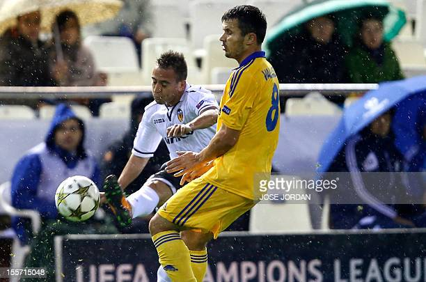 Valencia's Portuguese defender Joao Pedro da Silva Pereira vies with Bate Borisov's midfielder Aleksandr Volodko during the UEFA Champions League...