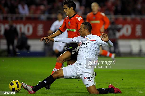 Valencia's Portuguese defender Ricardo Costa vies for the ball with Sevilla's Brazilian forward Luis Fabiano during their Liga football match Sevilla...